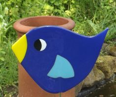 This fun bird is inspired by the birdsong I hear in my garden everyday and by some wonderful giant fused glass flowers I saw at a recent exhibition. I looked at them and thought, I want to make something BIG! The giant bird is designed and made by me in my garden studio, in