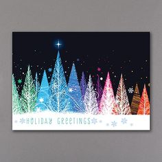 Colorful Trees - Holiday Card Light up the holidays for everyone on your list! Bold colors, modern patterns and swirls of snowflakes make this holiday card a bright spot in the season.