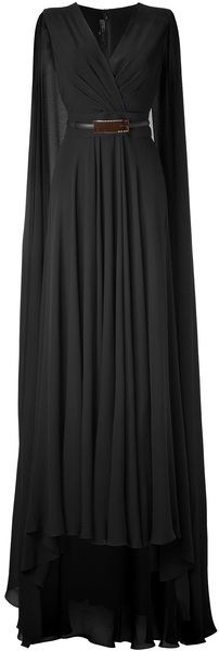 I think this is Solange's wedding dress in black. #ELIE SAAB Black Belted Cape Back Silk Georgette Gown - Lyst