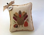 Hand stitched cross stitched fall pin cushion/bowl filler with turkey and pumpkins.