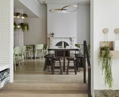 The Kettle Black Cafe in Melbourne | Designed by Studio You Me with furnishings from DesignByThem, the interior has a neutral palette of soft oak, hexagonal marble tiles, and brass finishes.