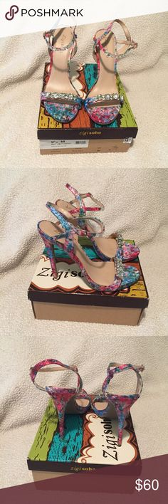 """Zigi Soho floral strappy heels with rhinestones. Heighten your style with this dress sandal from Zigi Soho. The Marlena mixes a beautiful watercolor floral print with jewel embellishments for a stunning addition to your next evening look. New with Box (I purchased these for a wedding in Mexico that I ended up wear flip flops to). Never worn, I tried them on a few times but on carpet. Two-piece printed fabric upper with Jewel embellishments. Quarter strap with adjustable buckle ½"""" platform…"""
