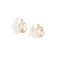 The Michelle earrings exemplify elegance. These exquisitely cut crystals catch light at every turn. With a textured gold border, this double sided drop pair exudes vintage appeal. Michelle will pair well with gold necklaces.  Find it on Splendor Designs