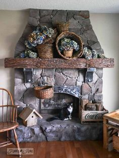 Hydrangea filled rustic baskets for a fall mantel - with cats. via http://www.funkyjunkinteriors.net