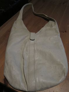 I just listed my vintage ivory leather HALSTON hobo bag on ebay for $10-happy bidding:) **SOLD**