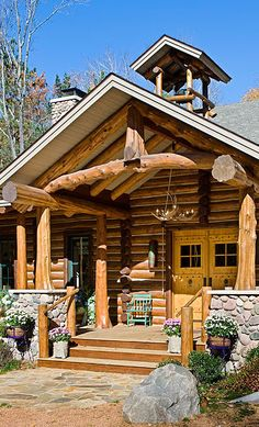 Cedar log home with a charming front entrance