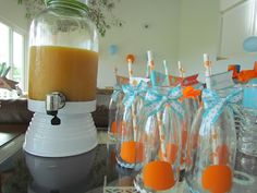 blue and orange whale second birthday party drink station bottles tied with ribbons