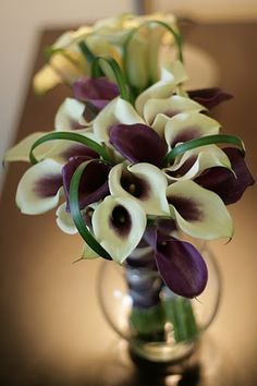 Picasso call lilies with lily grass/   Deland Florida wedding flowers/ Volusiacountyweddingflowers/ www.callaraesfloralevents.com