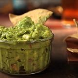Homemade guacamole involves nothing more than mashing together a handful of ingredients, and the flavor is far superior to the shelf-stable glop in the supermarket. Serve your fresh guac with some chips and salsa, and you've got yourself an instant party. It's also a delicious accompaniment to quesadillas. What to buy: Look for avocados that give slightly when pressed but are not completely soft. We used Hass avocados. This recipe was featured as part of both our Super Bowl for a Crowd menu…