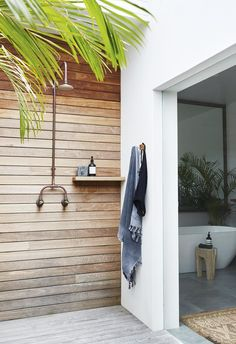 Ensuite The master ensuite upstairs opens out onto a private enclosed deck and open-air shower area. | Step inside this relaxed all-white Byron Bay home with upcycled details | Photography: Alicia Taylor