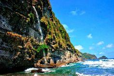 Secret beach water falls   Dominica