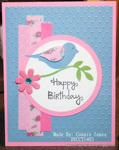 handmade birthday card by stamp300 ... pink and blue ... strips of patterned papers anchor layered circle medallion ... two-step bird punch in blue with pink flowered paper wing ... sweet look ...