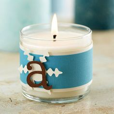 Personalize a store-bought candle for an inexpensive Christmas gift. Simply wrap cardstock around the candleholder, and embellish it with a die-cut accent and letter. No die-cutting tool? No problem -- use stickers instead.  Editor's Tip: Stock up on candles the next time they're on sale. They're easy to embellish, and they make great Christmas gifts.