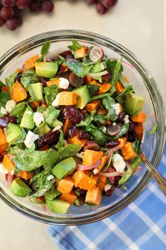 Roasted Sweet Potato Salad with Spinach, Grapes, Dried Cranberries, and Avocado   theroastedroot.net
