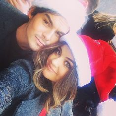 Pin for Later: Stars Get Into the Holiday Spirit in This Week's Celebrity Candids  Lucy Hale wore a Santa hat with her Pretty Little Liars costar.  Source: Instagram user lucyhale