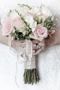 Blush Bridal bouquet using antique pink roses, white peonies and freesia.