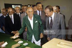 King Hassan Ii Of Morocco And His Son The Crown Prince Mohammed Sidi. Au Maroc, le 7 septembre 1992, devant des hommes non identifiés, le roi HASSAN II DU MAROC en veste verte, s'apprête à voter pour approuver la nouvelle constitution.