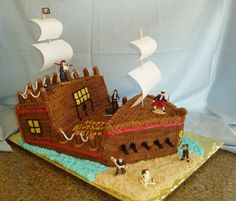 Pirate ship cake with ocean, sand and candle cannons.
