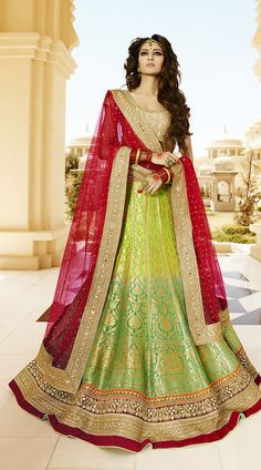 Womens Banarasi Silk Fabric And Green Color Pretty A Line Lehenga Style.You are bound to make a strong fashion statement with this Greenish Blue & Lime Green Viscose Satin Unstitched Lehenga Choli. This attire is nicely made with Resham & Butta Work work. Indian Wedding Lehenga, Pakistani Bridal, Bridal Lehenga, Indian Bridal, Lehenga Choli Designs, Lehenga Choli Online, Dress Indian Style, Indian Dresses, Indian Outfits