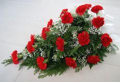 27 punainen neilikka - harso - Hautauspalvelu Sotaniemi