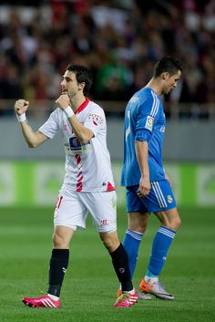 Nico Pareja celebrates his team's victory close to Cristiano Ronaldo after the La Liga match between Sevilla FC and Real Madrid CF at Estadio Ramón Sánchez Pizjuán on March 26, 2014 in Seville, Spain.