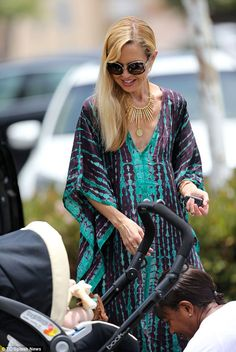 Boho chic: The fashion mogul wore her blonde hair loose and wavy over her shoulder and add...