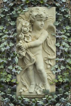 cherub plaque with ivy