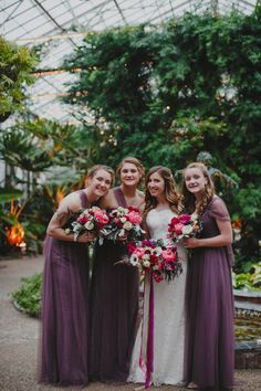 Long purple bridesmaid dresses and jewel-toned bouquets   Love Me Do Photography