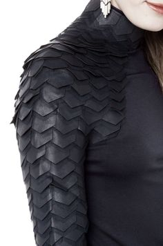 This is kind of random but LOOK AT THIS SHIRT. Apparently Kelly Sue deConnick was wearing this shirt one day at ECCC 2014. It looks complex, but not difficult to make. Turtleneck zips up the back, scales done in sets of a pleather/vinyl piece and a tulle/fine netting piece. Body fabric appears to be a thick, synthetic, stretch material. I am intrigued. Also Toothless.
