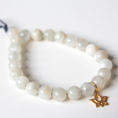 New Moonstone Bracelet with Gold Lotus Charm!  Over 60 more products up in the shop, with quite a few new $5 bracelets!!!  http://OneMindDharma.com/shop  #moonstone #gemstone #gemstonejewelry #lotus #oneminddharma