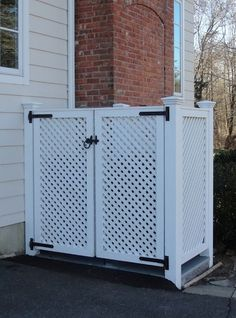 This trash enclosure, by West Hartford Fence, hides large trash and recycling bins behind sedate lattice doors. by West Hartford Fence Co., LLC (ours is going to be built around our pool equipment to camouflage it) kj Trash Can Storage Outdoor, Garbage Can Storage, Outdoor Trash Cans, Bin Storage, Garbage Can Shed, Patio Storage, Hide Trash Cans, Trash And Recycling Bin, Trash Bins