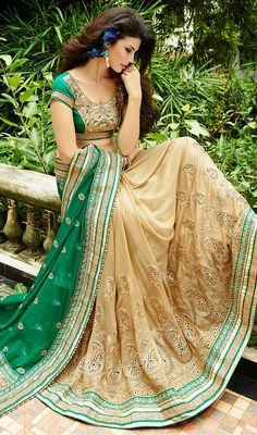 Showcase your voguish look dolled up in this beige and green color georgette net half n half sari. This attire is well created with bead, stones, lace and resham work. #creamcolorsarees #indiansaris #indianlooksari
