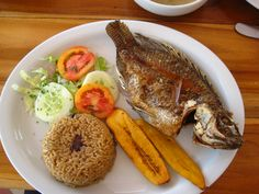 Fresh fish, coconut rice, and fried plantains. Cartagena, Colombia
