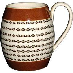 Miniature Creamware Slip Decorated Mochaware Childs Mug 1820 Dipt Rouletting  brilliant early miniature child size barrel shaped mug from mid-19th century, slip decorated in a brown black and tan color range. Decorated with a multi-step mochaware motif involving engine turned rouletted bands of circles or bubbles that are then dipped and filled, all against a creamware ground. The cup is unmarked.  The mug is in great condition with no chips cracks or repairs.