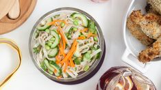 Noodly Asian Crunch Salad | Epicure.com 15 MIN PREP 20 MINUTES 280 CALORIES $0.00   Ingredients MAKES:10 SERVINGS juice of 2 limes 1 C (250 ml) rice vinegar 2 Tbsp (30 ml) Sesame Crunch Topper 2 Tbsp (30 ml) sugar 2 Tbsp (30 ml) low-sodium soy sauce 2 Tbsp (30 ml) vegetable oil 1 pkg (16 oz/454 g) rice noodles or udon or your favourite pasta 2 carrots thinly sliced, (Tip: use Epicure's Ceramic Slicer) 1 pkg (18 oz/500 g) frozen edamame (soy beans) or 2 cups (500 ml) frozen green peas, cooked…
