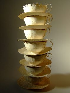 stack of papier mache teacups by Cecilia Levy.