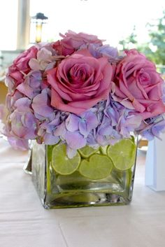 Modern purple hydrangea and lime centerpieces created by Matles florist in NYC
