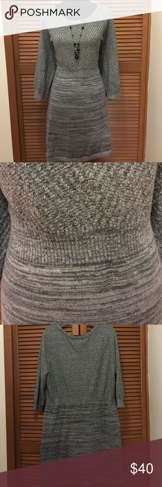 Lane Bryant plus size sweater dress 22/24 Gray In excellent condition! Looks great with black tights! Has a couple different shades of gray mixed with silver metallic threading. 90% cotton 7% polyester 3% other fiber. Lane Bryant Dresses