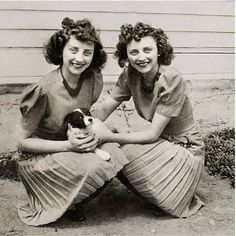 1940s Identical Twins Hold Puppy