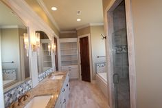 Master Bath with double vanities, granite, tile floors, and pendant lighting.