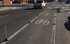 Someone in Kansas Created a Protected Bike Lane Using Toilet Plungers—and It's Amazing  http://www.bicycling.com/culture/advocacy/someone-in-kansas-created-a-protected-bike-lane-using-toilet-plungers-and-its?utm_source=facebook.com