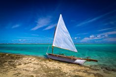A lonely boat awaits its sailor, somewhere on a deserted island in the Pacific. Purchase a print, cards, mugs, a phone case or a full size digital file of this image