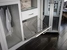 A built-in laundry basket allows you to hide dirty garments in a convenient albeit discreet fashion. #HGTVUrbanOasis