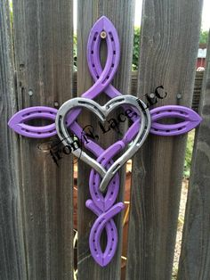 Horseshoe cross in rustic purple with heart in the by Horseshoe Projects, Horseshoe Crafts, Horseshoe Art, Horseshoe Ideas, Lucky Horseshoe, Welding Crafts, Welding Art, Welding Projects, Welding Ideas