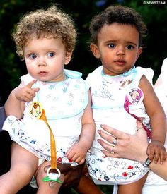 'Million to one' black and white twins celebrate first birthday.  Blue-eyed Marcia has inherited their mother Amanda's fair complexion and strawberry blonde hair. Millie is more obviously of mixed race and clearly takes after their father, Michael, who is of Jamaican origin.