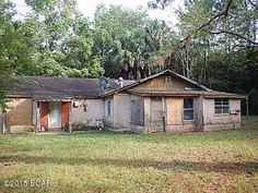 """Property sold in its """"AS-IS, WHERE-IS"""" condition. 2 bed, 1 bath Altha, FL home. This property will need extensive work and repairs. Structure should be fully inspected along with the roof. Home sits on 1 acre of flat land."""