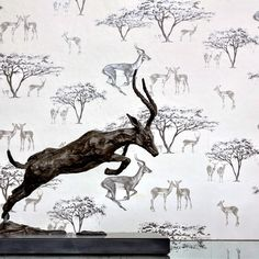 Here is a close up from the photoshoot of 'The Tribe' wallpaper with a matching impala statue sitting in front. @clareporritt #wallpaper #impala #antelope #october #inspiration #interiordesign #africa #safari #animalwallpaper #design #Decorex #decorexloves