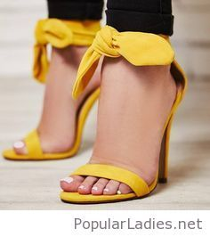 Yellow sandals and black pants