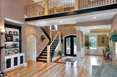 Obviously the house doesn't look like this but the concept of the balcony overlooking the living room from upstairs hallway is what I want