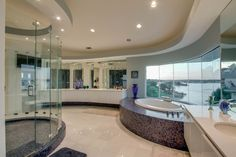 Contemporary Master Bath with a view :: Butted-glass windows offer a panoramic view...